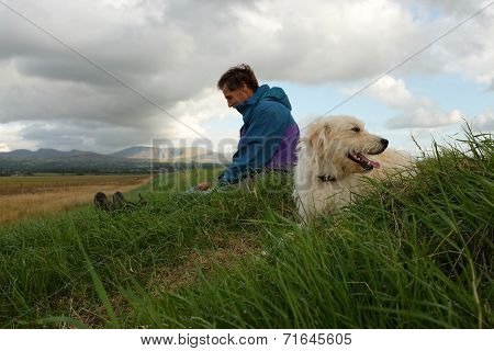 Labradoodle And Owner.