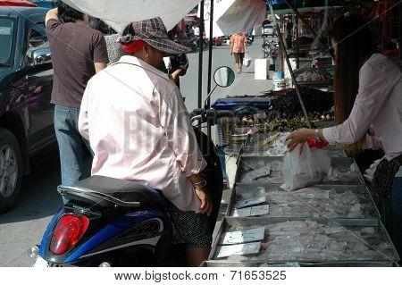 Woman Buying Fresh Seafood
