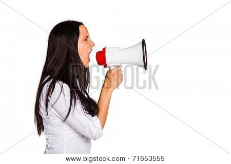 Young woman shouting through megaphone on white background