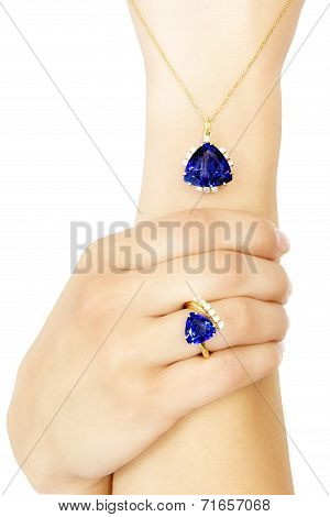 Closeup of a Model Wearing a Tanzanite Designer Ring and Pendant, Isolated on White