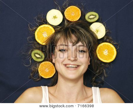 Smiling girl with fruits