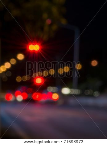 Abstract defocused lights of the night city bokeh background . poster