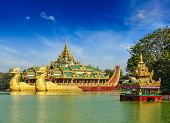 Yangon icon landmark and tourist attraction:  Karaweik - replica of a Burmese royal barge at Kandawgyi Lake, Yangon, Myanmar (Burma) poster