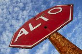 Stop alto sign with sky in background poster
