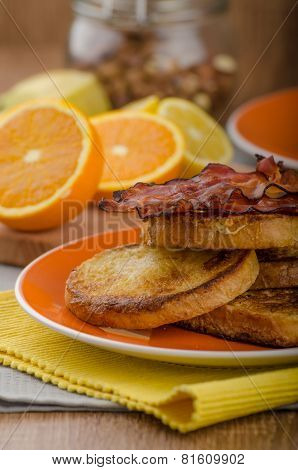 French toast with bacon and fresh juice from oranges poster