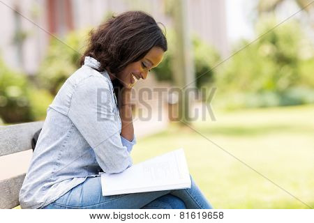 smart african uni student reading a book