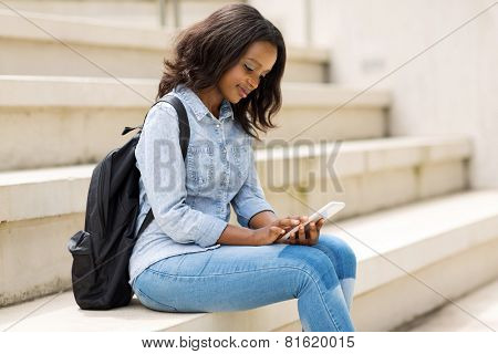 beautiful young college student using smart phone on campus