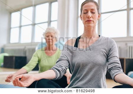 Women Mediating In Yoga Class