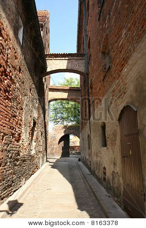 European architecture: an alley in the polish city of Torun poster