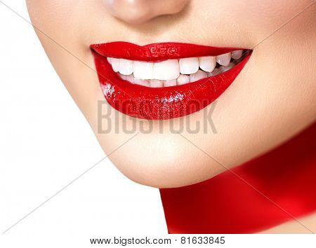 Beauty woman with perfect smile. Beautiful Model Girl with red lips and red silk scarf isolated on white background. Teeth whitening. Holiday make up, perfect skin