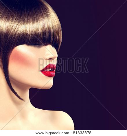 Beauty fashion model girl with glamour haircut, long fringe. Beautiful brunette woman face, perfect makeup, sexy red lips. Smooth brown hair. Make-up. Haircut. High Fashion Trendy Fringe Hair style