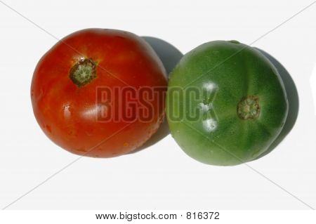 A red and green tomato isolated on a white background
