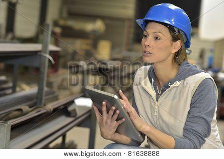 Woman engineer in steel plant using tablet