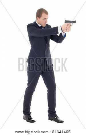 Special Agent Man In Business Suit Posing With Gun Isolated On White