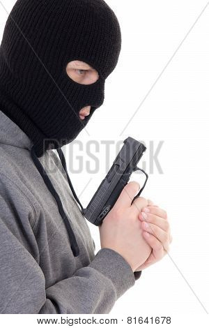 Profile View Of Criminal Man In Mask Holding Gun Isolated On White
