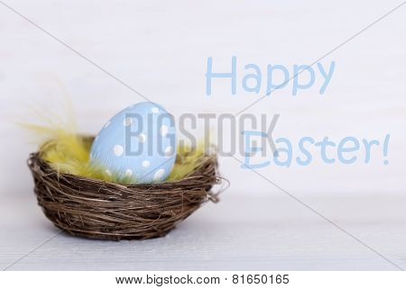 One Blue Easter Egg In Nest With Happy Easter