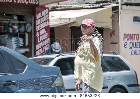 Elderly Fisherman In The Street