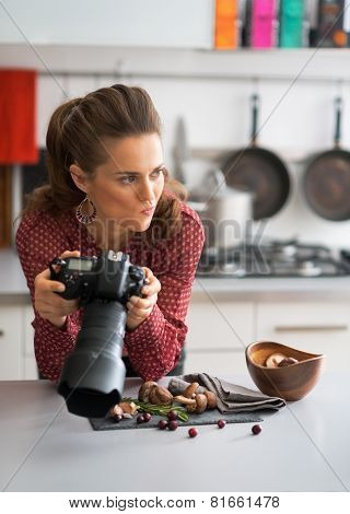 Concerned Female Food Photographer Checking Photos In Camera