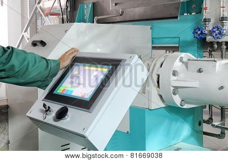Man Operating Factory Machinery