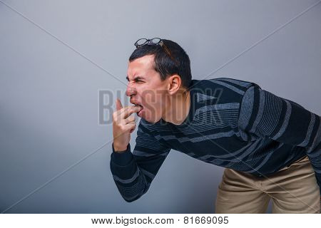 male of European appearance brunette put his fingers in mout