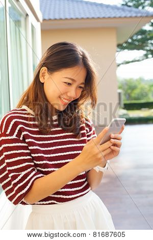 Portrait Of Beautiful Young Woman Reading Message In Smart Phone Use For Modern People Digtal Life I