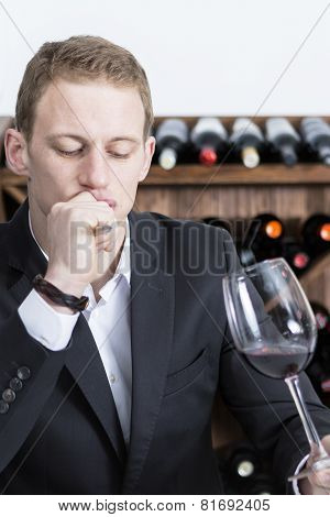 Man Evaluating A Red Wine.