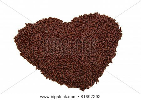 Heart shape formed with chocolate sprinkles isolated on white background. Love. Valentine's Day
