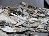 close view of pile paint chips removed from wall poster