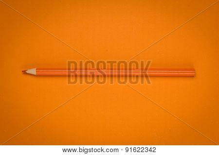 Orange Pencil On Orange Paper