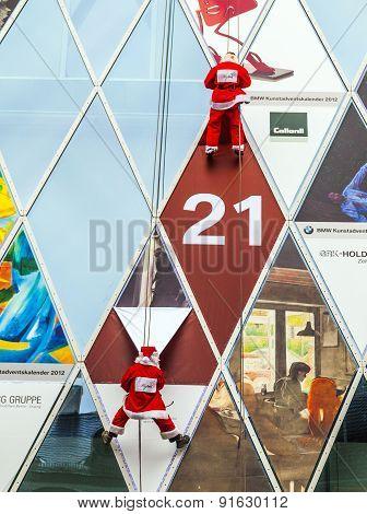 Two Climber Dresses As Santa Claus Climb Down The Myzeil Facade