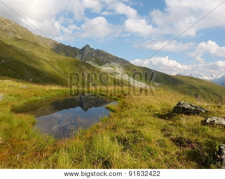 Mountain Lake with Reflection in the Austrian Alps
