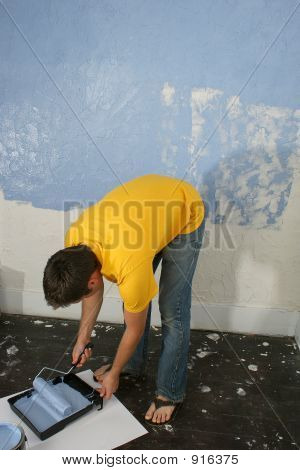 man painting wall blue. painting painter caucasian home poster