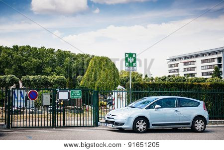 Meeting Point In Front Of Cemetery With Parked Car