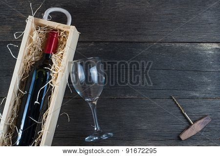 Wooden Wine Case With Red Wine On Rustic Background