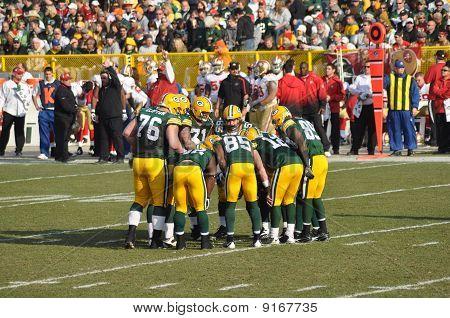 Green Bay Packers Huddling