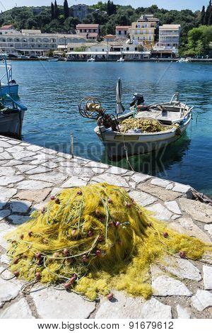 Fishing boat in the small harbor village of Kassiopi, Corfu, Greece