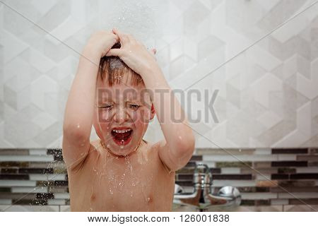 Cute little boy child taking in the bath. The symbol of purity and hygiene education.