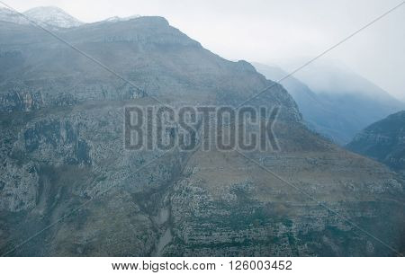 View over misty montain rock in the Moraca river canyon in north Montenegro, Balkan peninsula, in winter