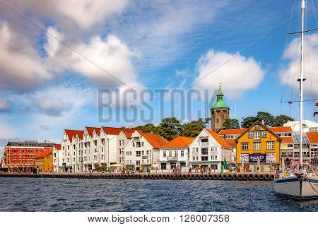 STAVANGER, NORWAY - JULY 15, 2015: People at the quay port with many restaurants and pubs in the city centre of Stavanger. Stavanger is one of most famous cruise travel destinations in Europe.