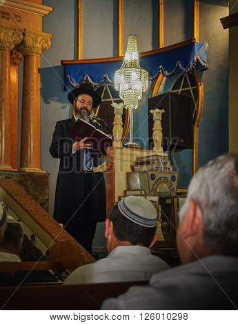 PETACH-TIKVA, ISRAEL - APRIL 22, 2015:  As the book says... - Chief Rabbi of Petach-Tikva, Rabbi Benjamin Atias quotes from the book during his lecture to the congregation.
