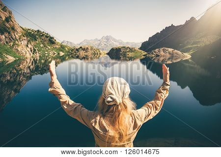 Woman Traveler meditating harmony alone Travel healthy Lifestyle concept lake and rocky mountains landscape on background outdoor poster