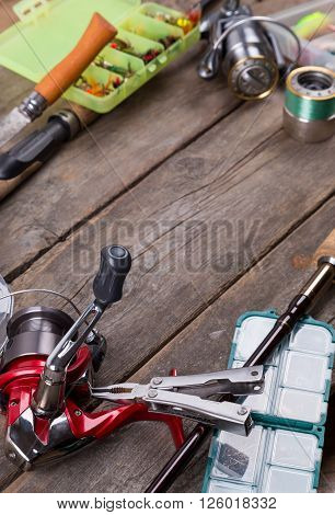 Fishing Tackles And Baits On Wooden Board