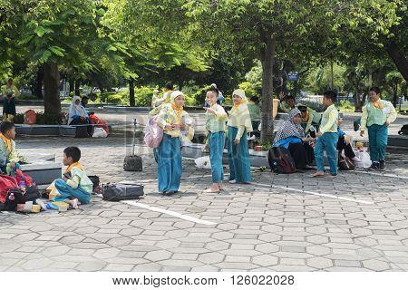SUBANAYA - MARCH 23 2016. Children playing in the courtyard of the mosque Allah at Al-Akbar Mosque (Masjid Raya) in Surabaya Indonesia.