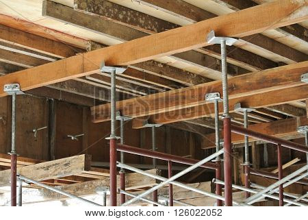 SELANGOR, MALAYSIA -FEBRUARY 11, 2015: Scaffolding used to support a platform or form work as the temporary structure at the construction site for construction workers to work.