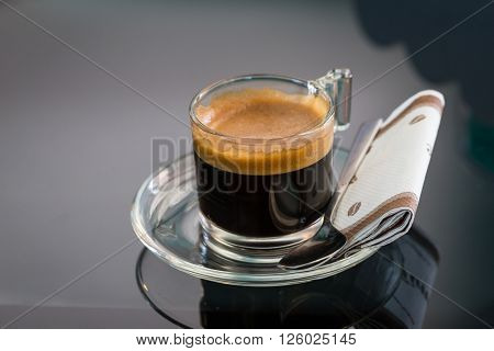 Hot black coffee cup with tissue paper