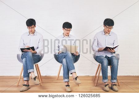 Brick interior with three different photos of one man organized into one picture collage. In the first picture the man is writing in the second one - using a laptop in the third one - reading