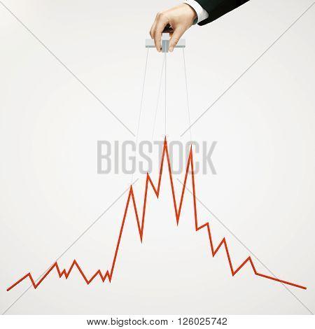 Businessman hand manipulating graph on light background