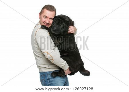 Man holding black adult shar pei dog on hands. Isolated over white background. Copy space.