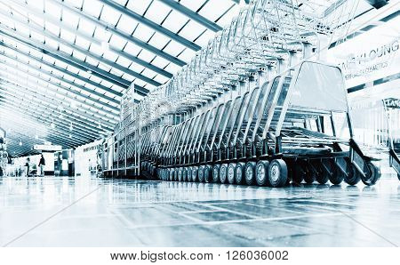 number of luggage carts at modern airport blue colored