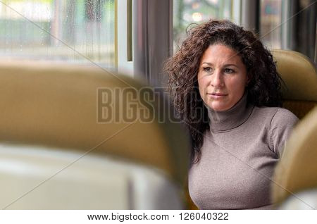 Attractive Thoughtful Woman Travelling By Train